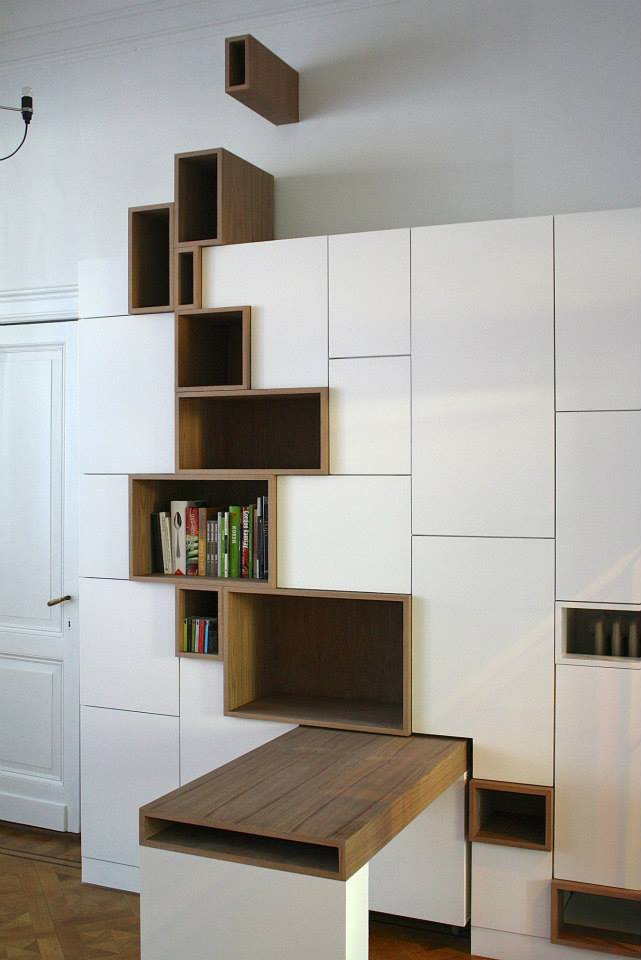 modern storage unit features stylized shelving mimicking a