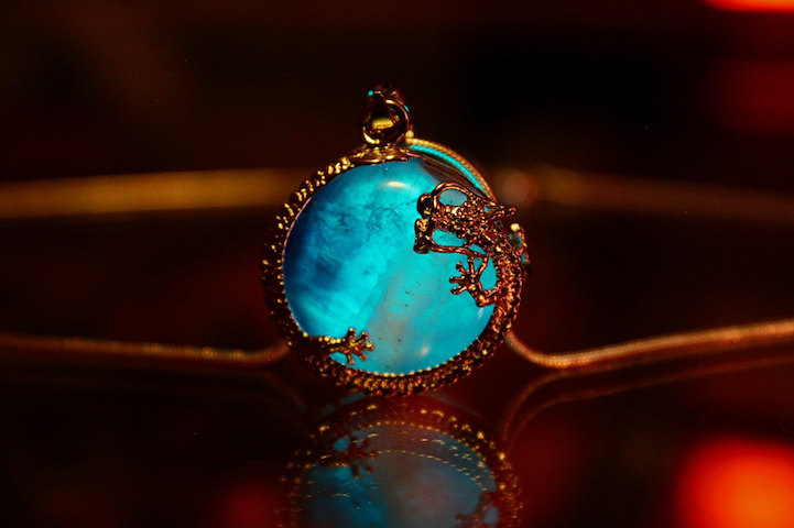 Mystical glow in the dark jewelry emits an ethereal turquoise glow aloadofball Images