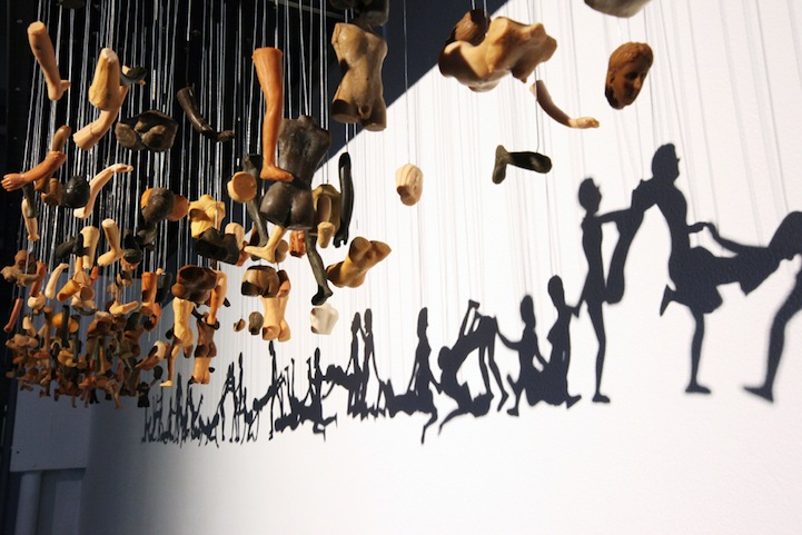 Unity Line Art Map : Provocative shadow art created through suspended doll parts